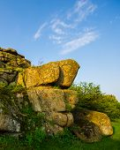 stock photo of old stone fence  - old stone blocks against the sky spring season - JPG