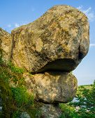 image of old stone fence  - old stone blocks against the sky spring season - JPG