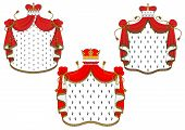 stock photo of tassels  - Majestic royal red velvet mantels with gold crowns ornate decorated white spotty fur - JPG