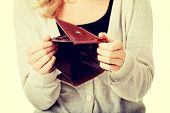foto of payday  - Young caucasian woman with empty wallet  - JPG