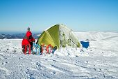 image of tent  - Tent stands in the mountains in the snow - JPG