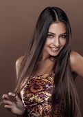 stock photo of mulatto  - cute happy young indian real woman in studio close up smiling - JPG
