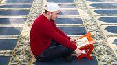 image of muslim kids  - Photo of the Young muslim man showing Islamic prayer - JPG