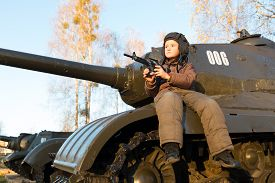 pic of panzer  - Portrait of young boy sitting on panzer - JPG