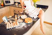 picture of cake-mixer  - Cropped image of housewife sitting on the table with cake ingredients selective focus - JPG