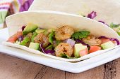 stock photo of cilantro  - High resolution two spicy shrimp taco with avocado - JPG