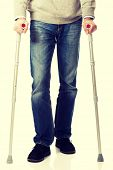 stock photo of crutch  - Mature male legs with crutches - JPG