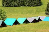 stock photo of boy scouts  - tents of a campsite of the boy scouts in the mountains in summer - JPG