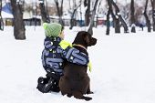 pic of dog park  - Kid of school age with dog in winter park - JPG