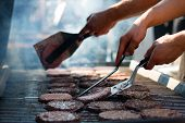 """picture of bbq food  - Cooking a burger outside on a giant BBQ at a event """"2000 burgeri"""" ** Note: Visible grain at 100%, best at smaller sizes - JPG"""