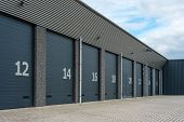 pic of garage  - Gray numbered business units or garages with shutter doors - JPG
