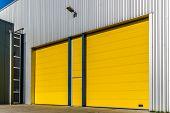 pic of roller door  - two yellow doors in a business building - JPG