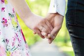 stock photo of fiance  - Holding hands close - JPG
