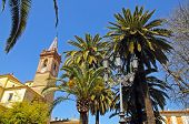 image of senora  - Our Lady of Rest church and palm trees - JPG