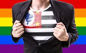 picture of south american flag  - Businessman stretching suit with Sao Paulo Flag with rainbow flag - JPG