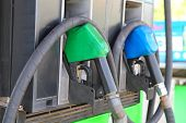 image of petrol  - Green and blue Fuel nozzle at the Petrol station - JPG