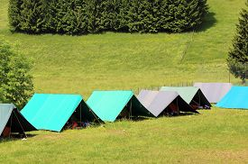 picture of boy scout  - tents of a campsite of the boy scouts in the mountains in summer - JPG