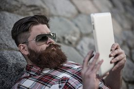 pic of moustache  - Handsome big moustache hipster man in the city with tablet - JPG