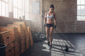 Fitness Female Getting Ready For Intense Crossfit Workout poster