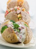 stock photo of baked potato  - Baked Potatoes with a Selection of Toppings - JPG