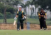 PUCHONG, MALAYSIA - SEPT 24: Guernsey loses another wicket in Adam Martel's dismissal, at the Pepsi