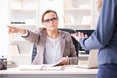 Angry boss dismissing employee for bad underperformance poster