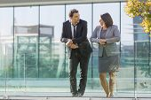 Serene Calm Business Colleagues Leaning On Glassy Railing While Resting Outdoors. Serious Confident  poster