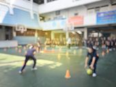 Blurred Image Of Children Or Male And Female Students In Secondary School Are Learning Football Or S poster