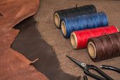 Tools For Leather Crafting And Pieces Of Brown Leather. Manufacture Of Leather Goods. poster