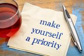 Make yourself a priority advice - handwriting on a napkin with a cup of tea poster