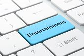 Entertainment, Concept: Computer Keyboard With Word Entertainment, Selected Focus On Enter Button Ba poster