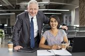 Business Portrait Of Smiling Experienced Mentor And New Hire. Positive Mature Man In Suit Posing Wit poster