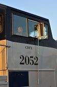 picture of amtrak  - Engineer in cab of Amtrak locomotive prepares to leave the station - JPG