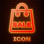 Glowing Neon Shoping Bag With An Inscription Sale Icon Isolated On Brick Wall Background. Handbag Si poster