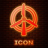 Glowing Neon Rotating Wind Turbine Icon Isolated On Brick Wall Background. Wind Generator Sign. Wind poster