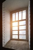 Rays Of The Sun At Sunset Make Their Way Through A Large Old Window In A Tower With Thick Stone Wall poster