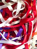 Abstract Multicolor Background. Texture Of Mixed Multicolored Satin Thin Ribbons. Vertical, Close-up poster