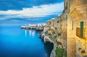 Polignano A Mare Village On The Rocks At Sunset, Bari, Apulia, Southern Italy. Europe. poster