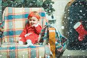 Christmas Babies. Cute Little Baby Child On Christmas Tree Background. Happy Children. Little Baby G poster