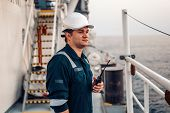 Marine Deck Officer Or Chief Mate On Deck Of Offshore Vessel Or Ship , Wearing Ppe Personal Protecti poster