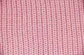 Knit Close-up. Colored Knitted Wool Close-up. Pink Background. Close Up Of Pink Colored Wool Textile poster