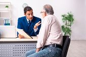 Financial advisor giving retirement advice to old man poster
