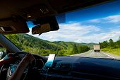Family Traveling By Car In The Mountains Of The Altai Are Driving By Serpentine Road With Navigation poster