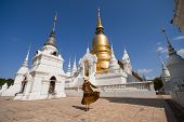 Woman Hipster Is Sightseeing Inside Wat Suan Dok In Chiangmai, Thailand. poster
