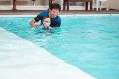 Asian Father And Son Takes A Swimming Lesson At Indoor Swimming Pool, Cute Little Asian 2 Years Old  poster