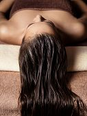 young  woman receiving hair care procedure  in spa salon. Beauty treatment. Spa salon poster