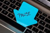 Writing On Colorful Sticky Note Pause. Text With Pause On Paper. Sticky Note, Post It On Keyboard. poster