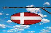 Denmark Flag On Signboard. Oval Signboard Colors Denmark Flag Hanging On A Metal Forged Structure. T poster