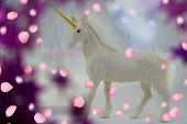 The White Glittering Unicorn With Glitters And A Gold Corner In The Middle Of A Purple Circle With S poster