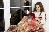 Carried Away Into World Of Fantasy. Small Girl Read Fantasy Book On Windowsill. Little Child Enjoy R poster